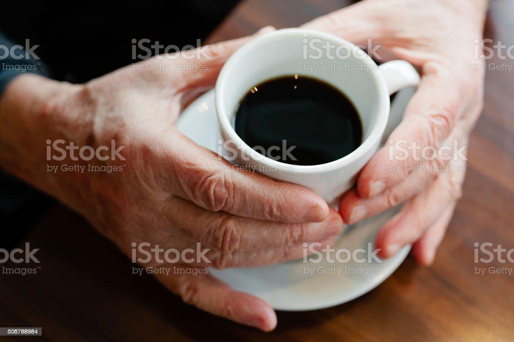 Senior man having coffee stock photo