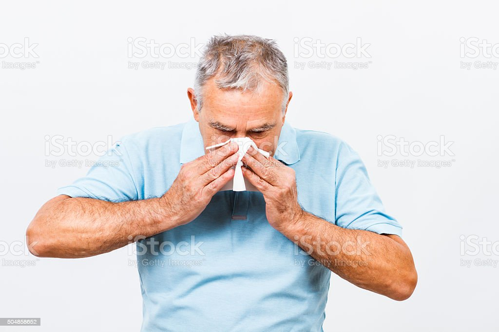 Senior man having flu stock photo