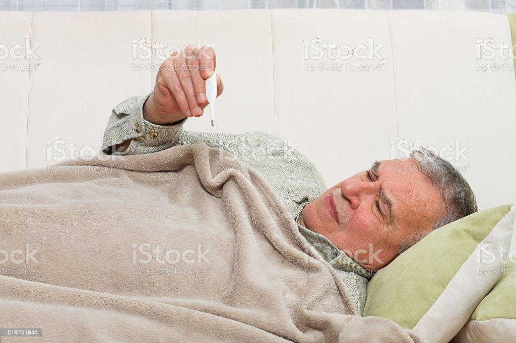Senior man having flu stock photo