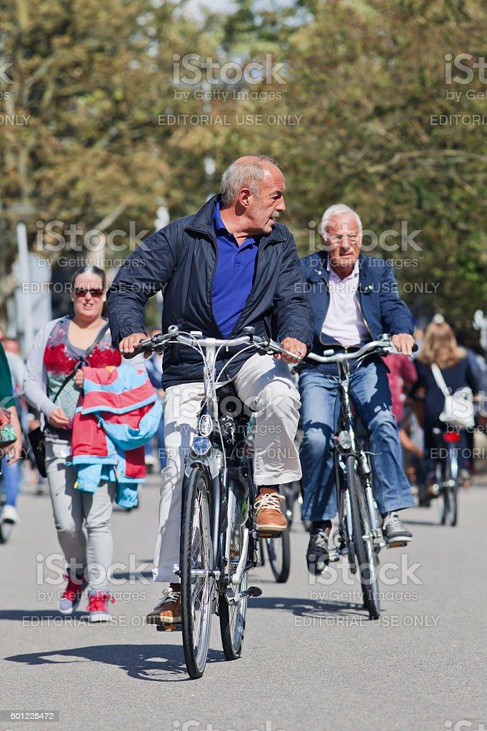 Senior man having fun cycling in the Vondelpark, Amsterdam stock photo