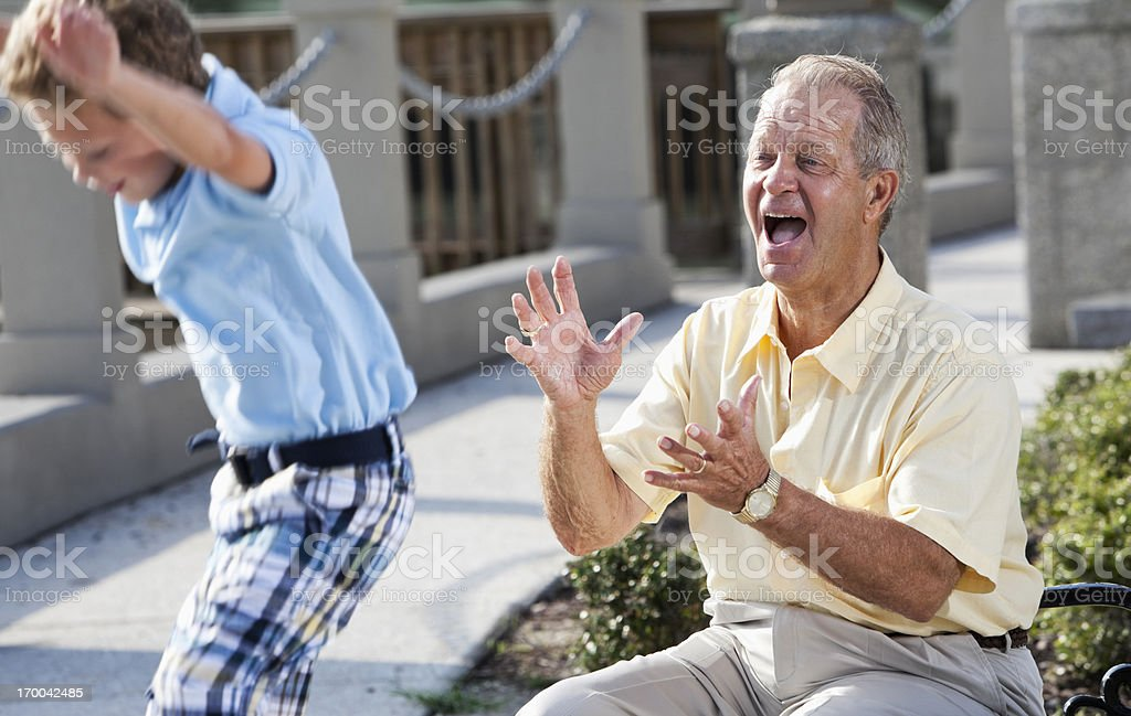 Senior man having fun with grandson stock photo