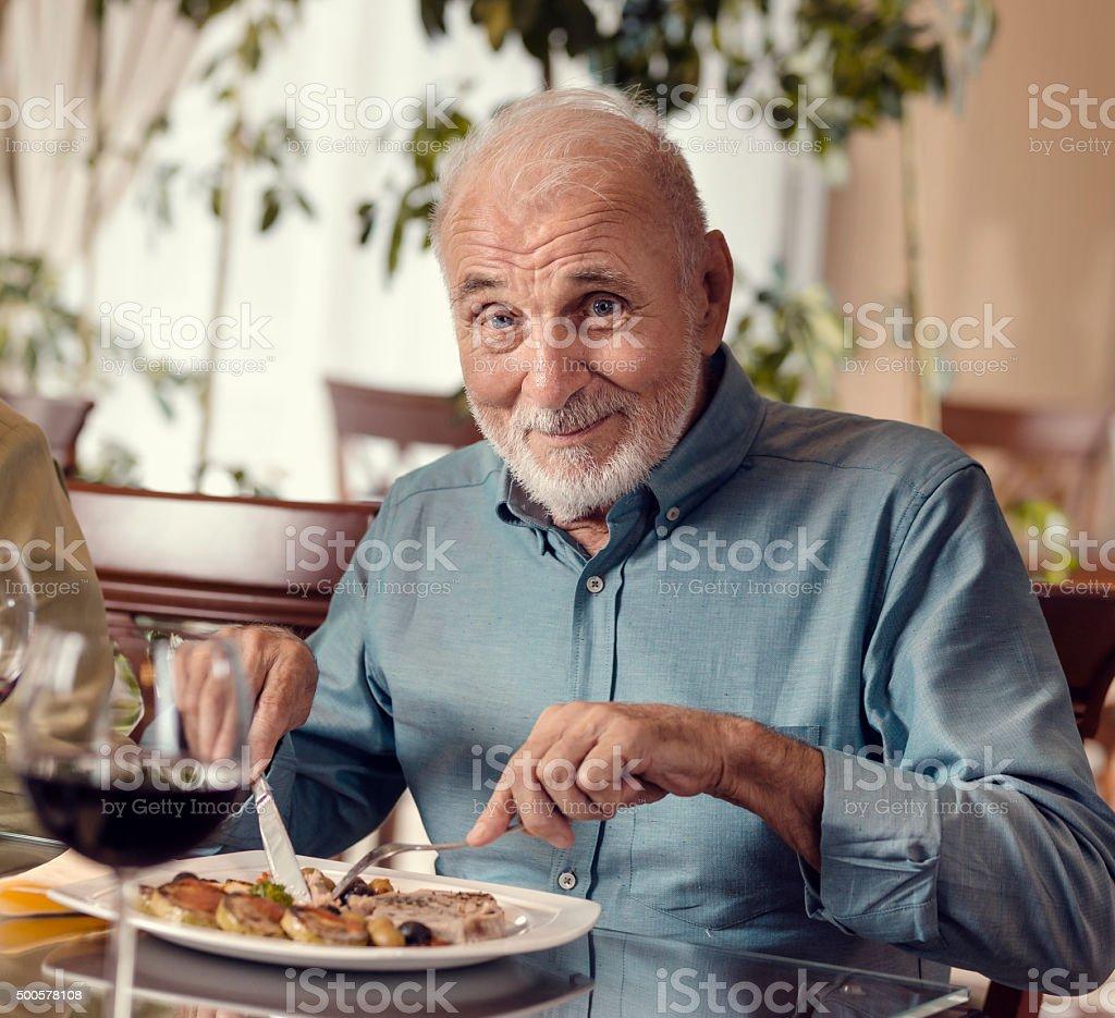 Senior Man Having Lunch stock photo