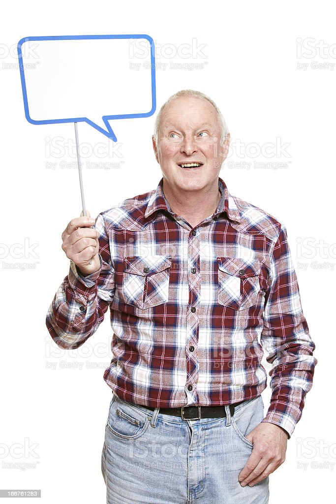 Senior man holding a speech bubble sign smiling royalty-free stock photo