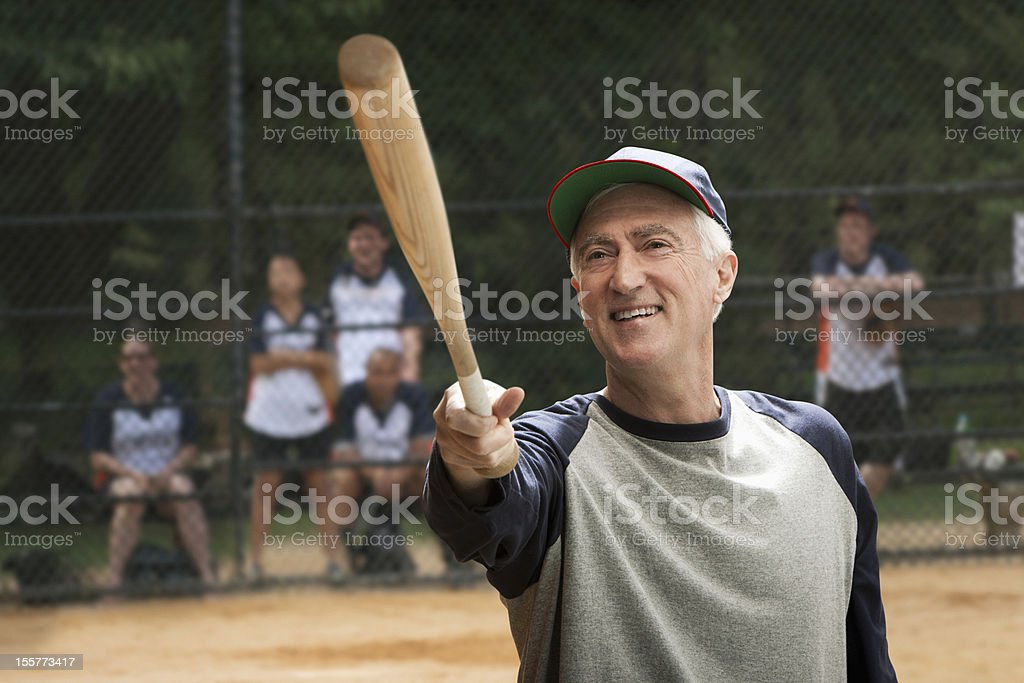 Senior man holding baseball bat stock photo
