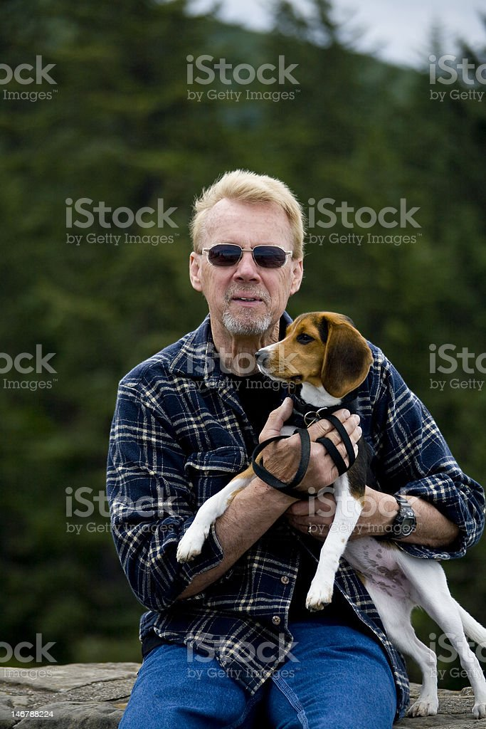 Senior Man Holding Beagle Puppy stock photo