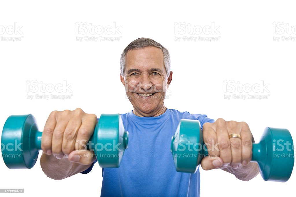 Senior man holding dumbbells towards camera stock photo