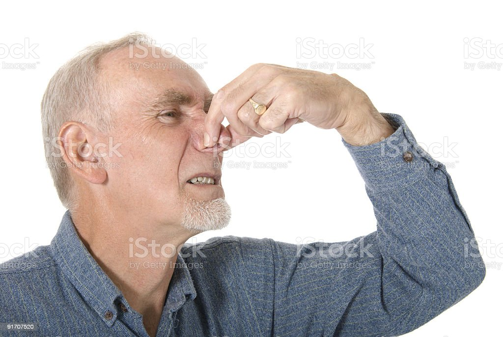 Senior man holding his nose royalty-free stock photo