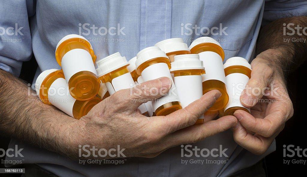 Senior Man Holding Several Medicine Bottles royalty-free stock photo