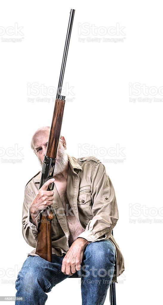 Senior Man Holding Shotgun Pointed Upwards stock photo