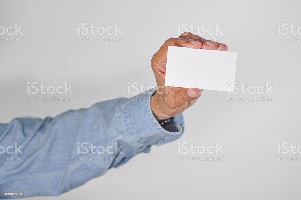 Senior man holding up a blank card. royalty-free stock photo