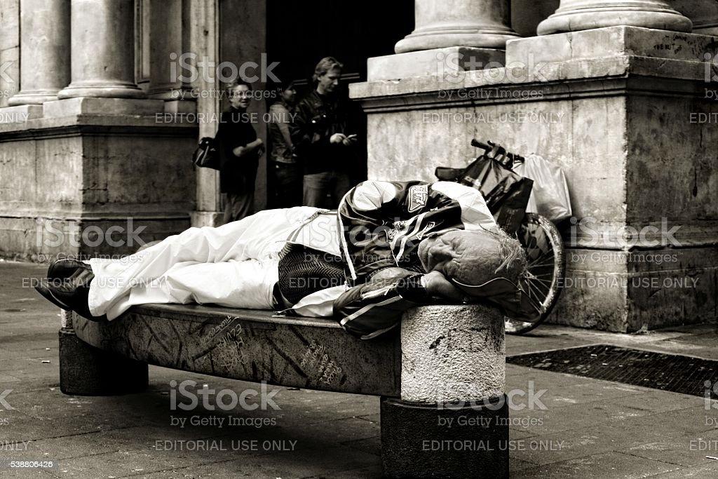Senior man homeless sleeping on bench Naples Italy Black White stock photo