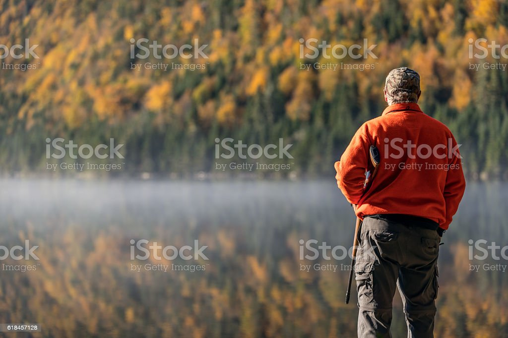 Senior Man Hunter Relaxing in Nature stock photo