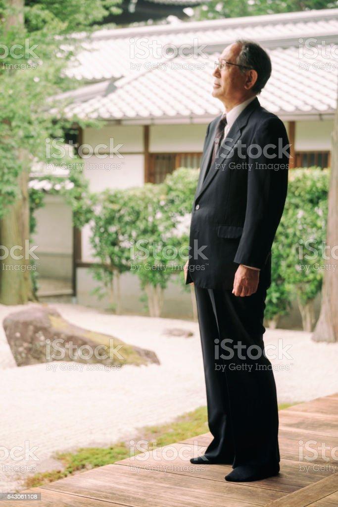 Senior Man in a Buddhist Temple stock photo
