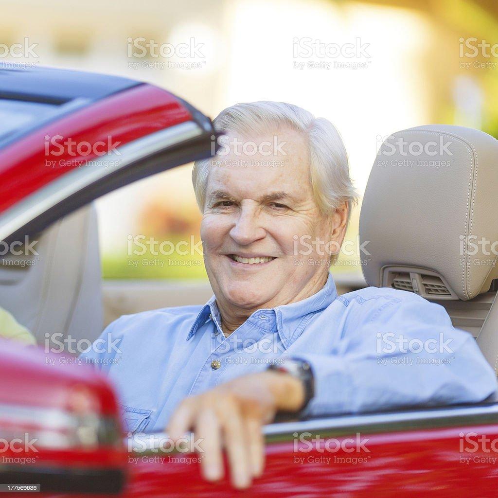 senior man in a car stock photo