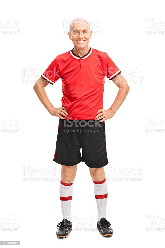 Senior man in a red football jersey stock photo