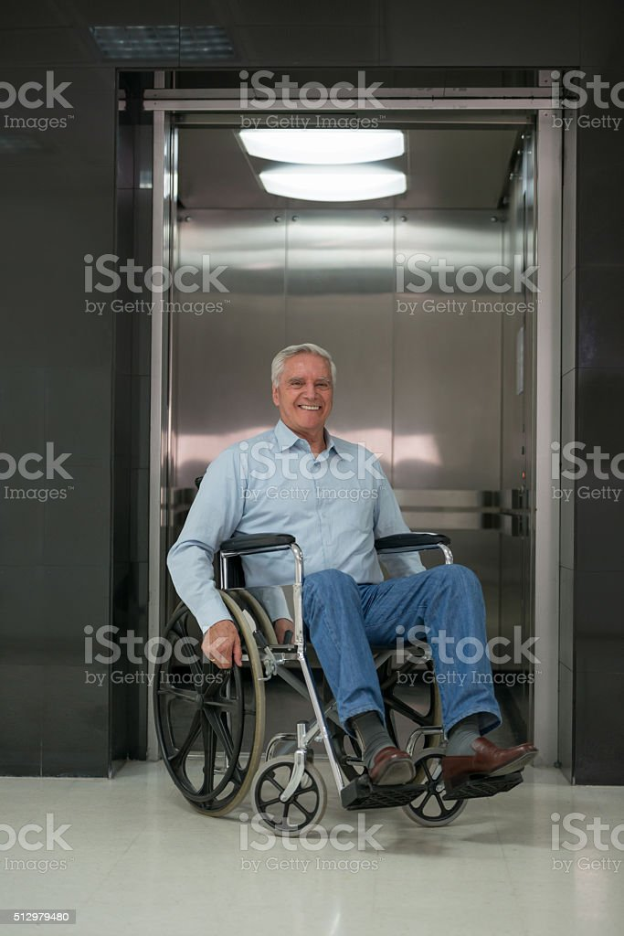 Senior man in a wheelchair at the hospital stock photo