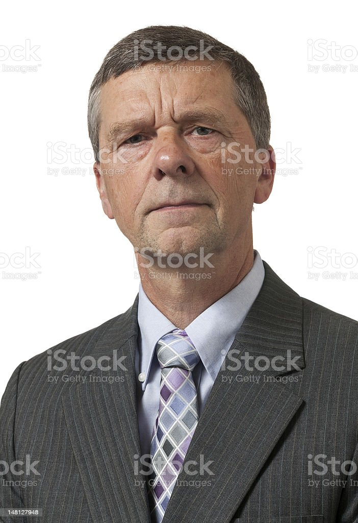Senior man in blue shirt looks pensive royalty-free stock photo