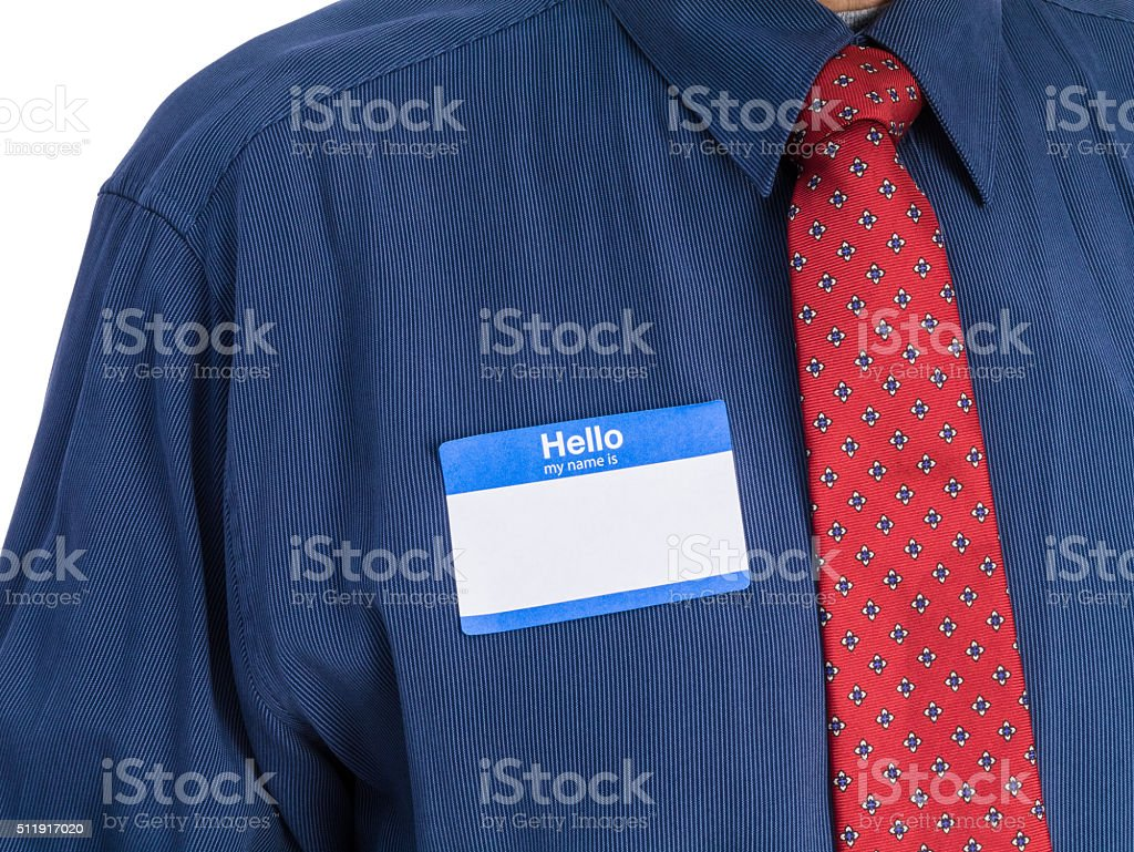 Senior Man in Blue Shirt with Tie and Name Tag stock photo