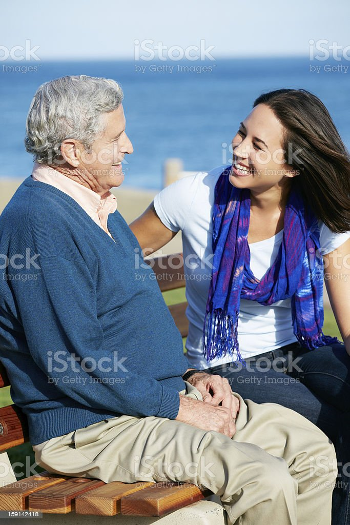 A senior man in blue speaking to her daughter near the sea royalty-free stock photo