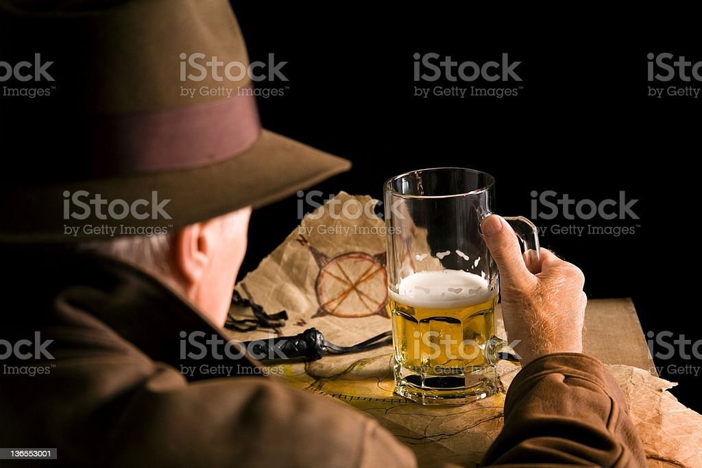 Senior Man in brown leather jacket sitting at table stock photo