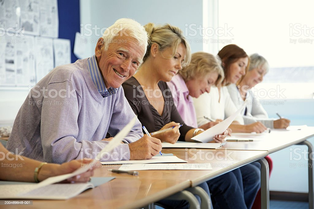 Senior man in classroom, smiling, portrait royalty-free stock photo