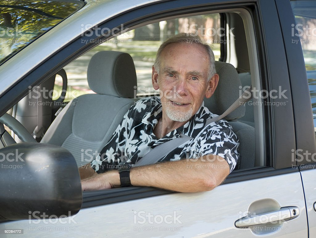 Senior man in driver's seat of car royalty-free stock photo