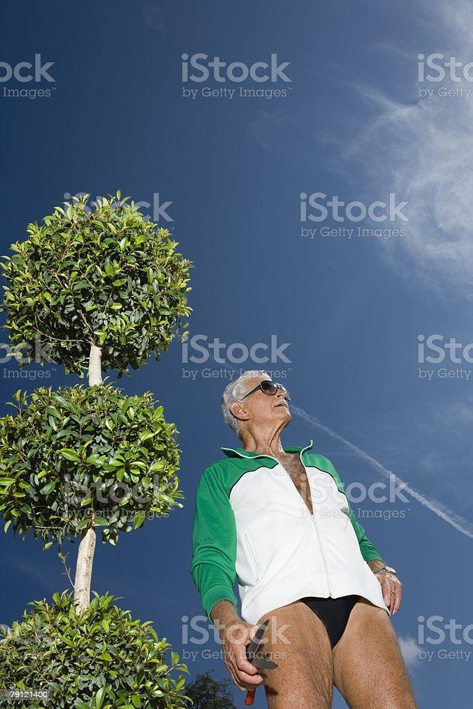 Senior man in garden stock photo