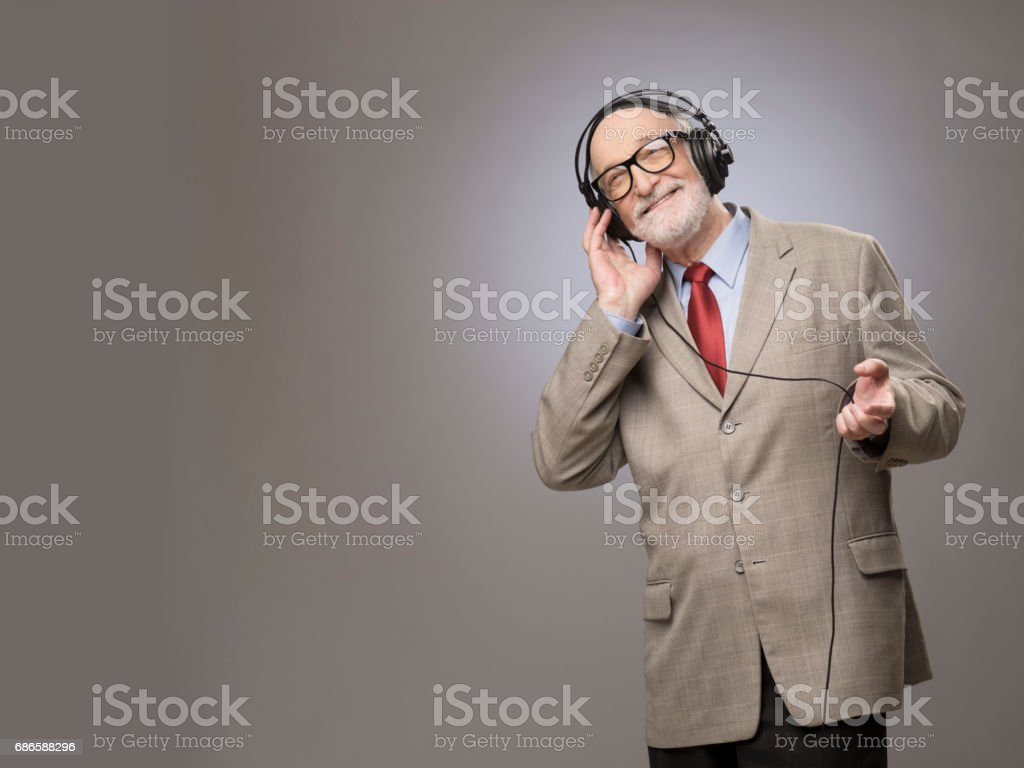Senior man in headphones stock photo