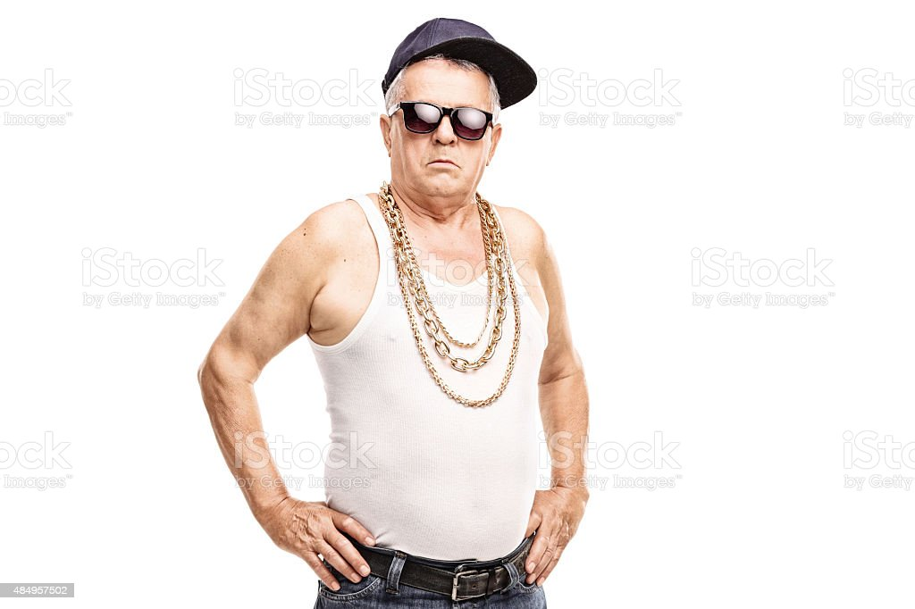 Senior man in hip-hop clothes looking at the camera stock photo