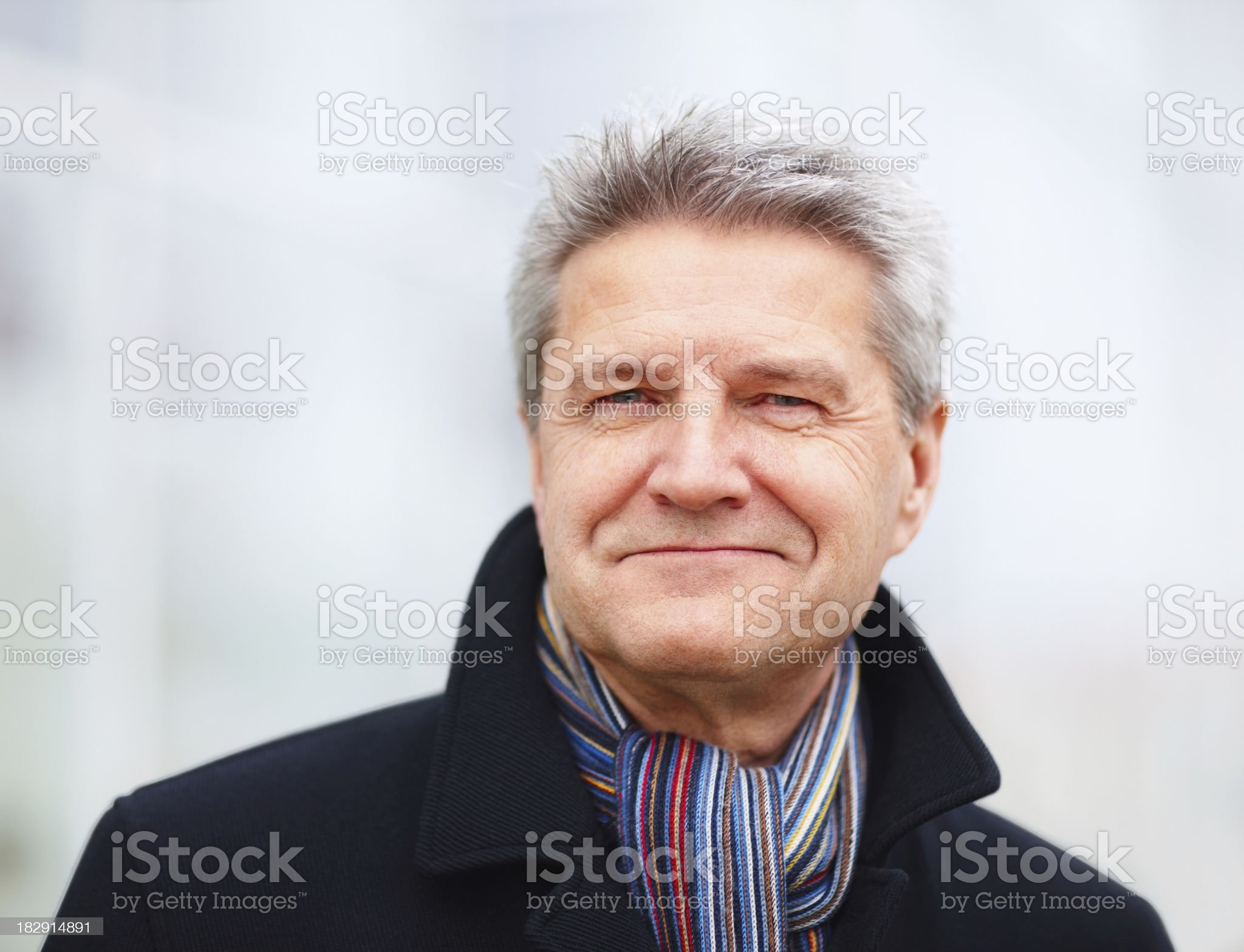 Senior man in jacket with muffler around his neck royalty-free stock photo