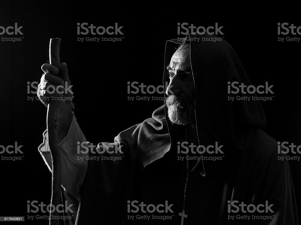 Senior man in medieval costume in dark stock photo