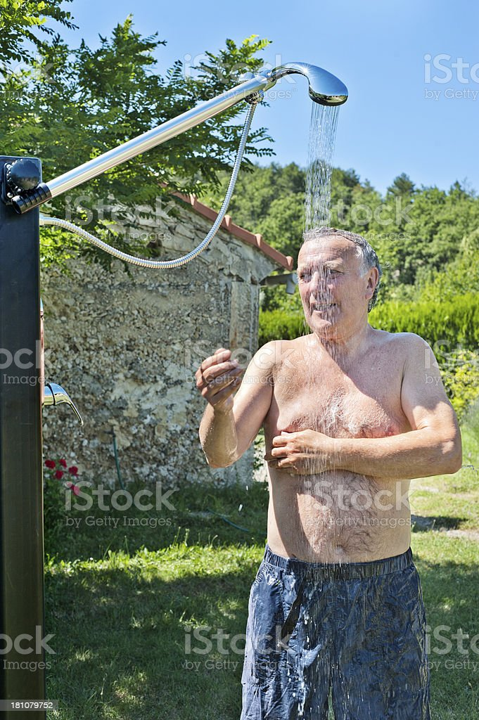 Senior man in outdoor shower royalty-free stock photo