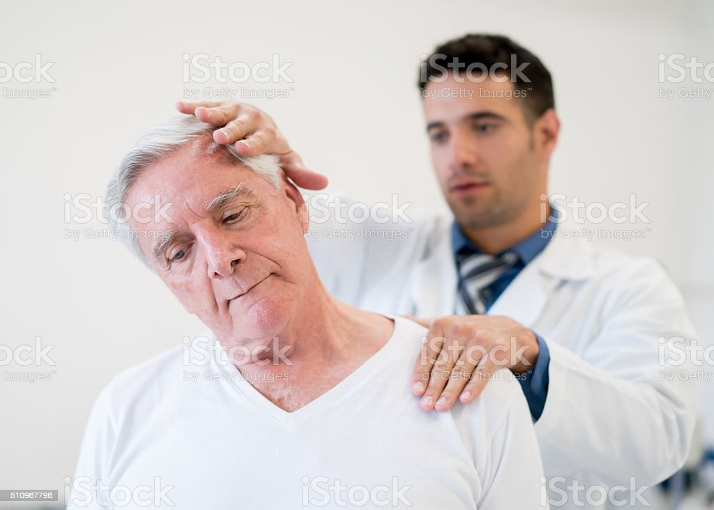 Senior man in physiotherapy stock photo