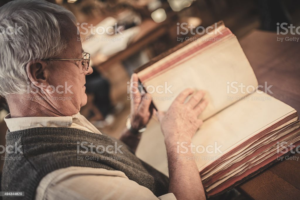 Senior man in public library stock photo