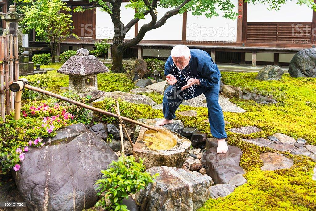 Senior man in temple garden stock photo