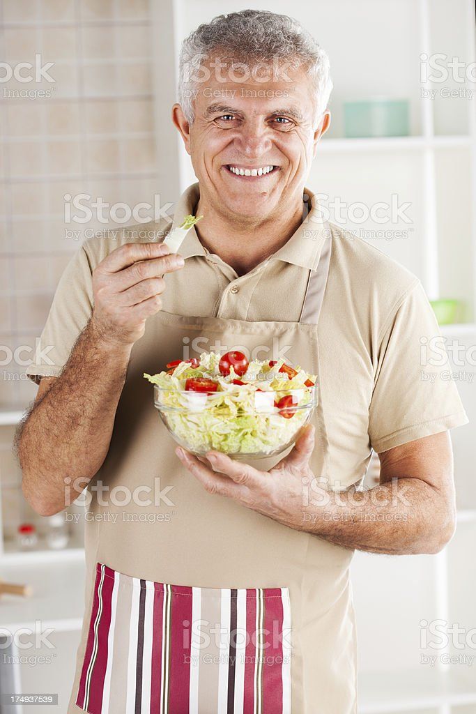 Senior man in the kitchen royalty-free stock photo