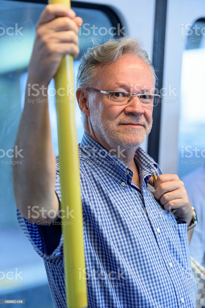 Senior man in the metro stock photo