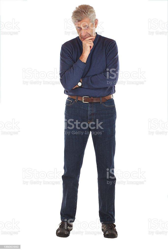 Senior man in thoughtful pose stock photo