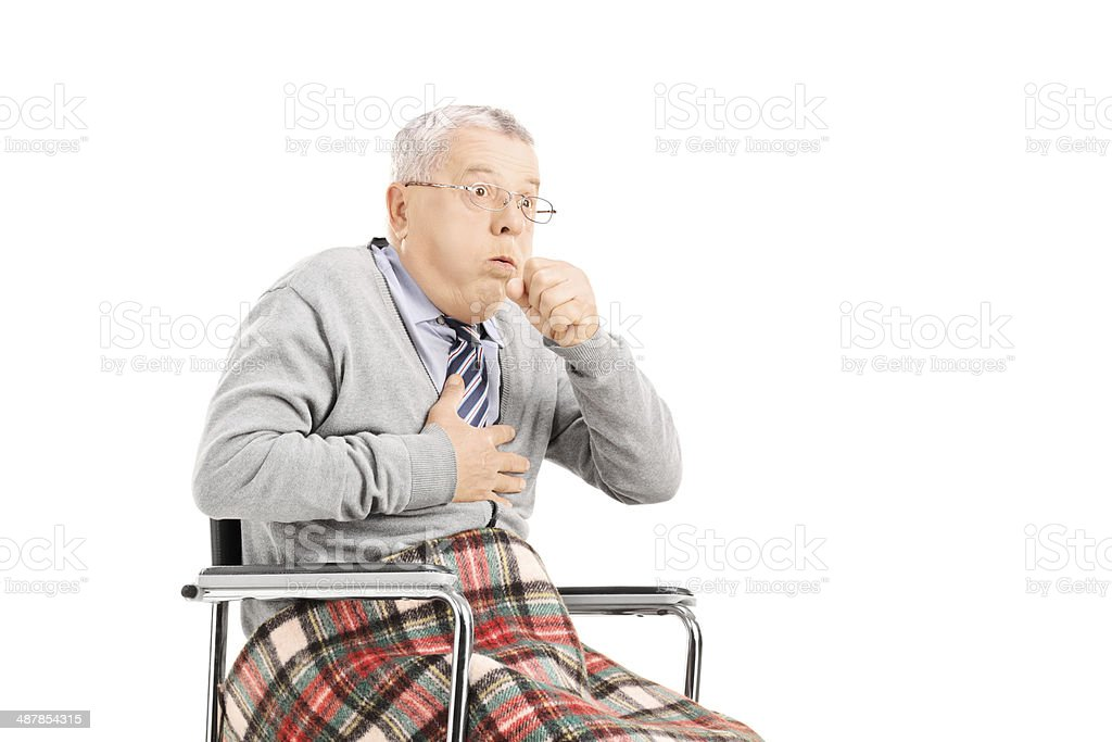 Senior man in wheelchair, choking stock photo