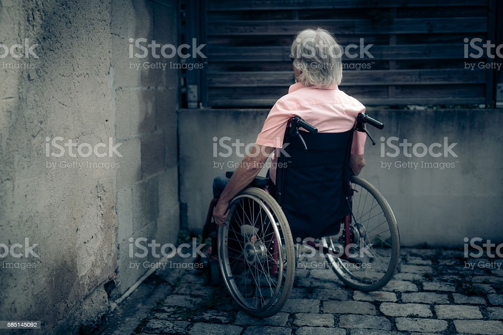 Senior man in wheelchair, isolation and loneliness concept stock photo