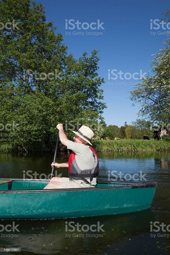 Senior man kayaking stock photo