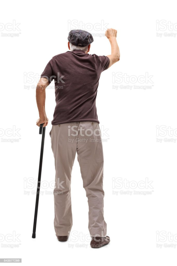 Senior man knocking on a door stock photo