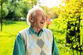 Senior man laughing.