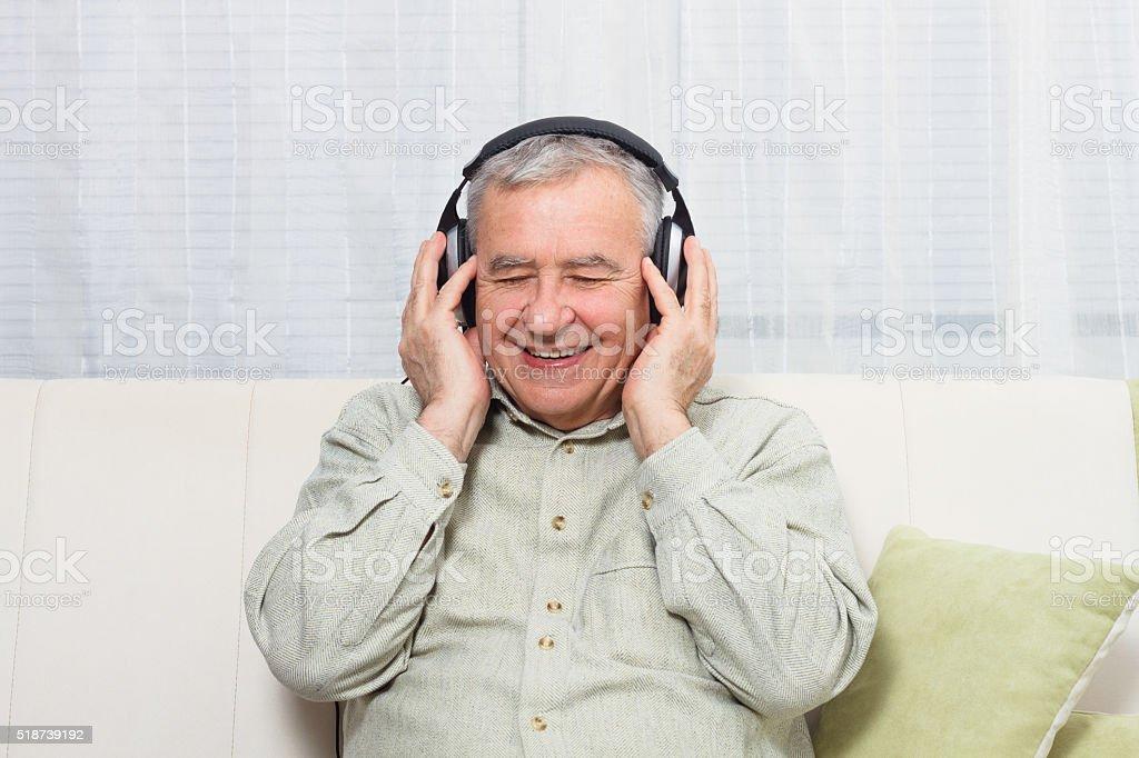Senior man  listening music stock photo