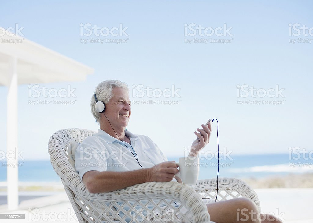 Senior man listening to mp3 player royalty-free stock photo