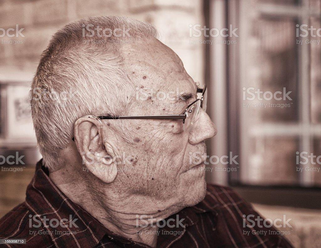 Senior Man Listening With Hearing Aid royalty-free stock photo