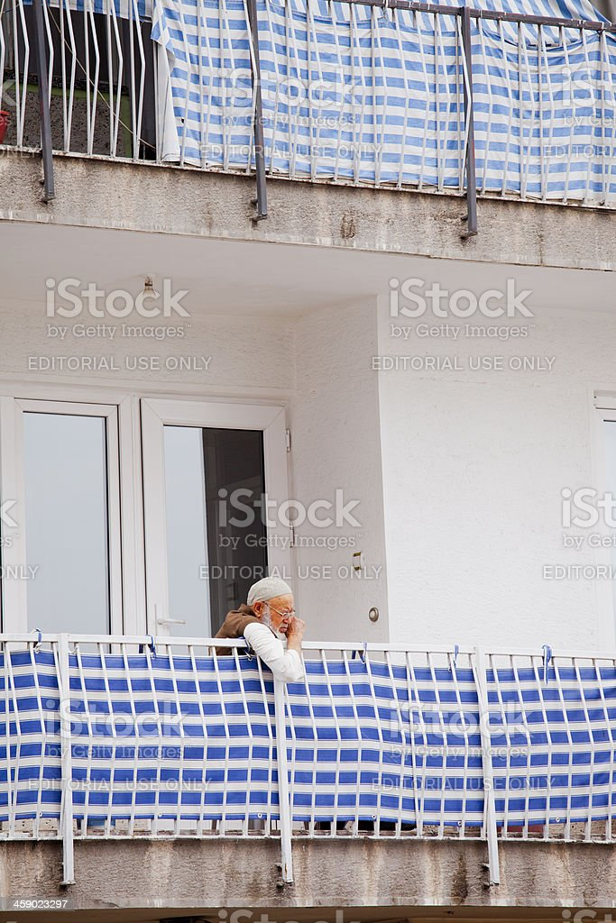 Senior Man Looking Around on balcony. royalty-free stock photo
