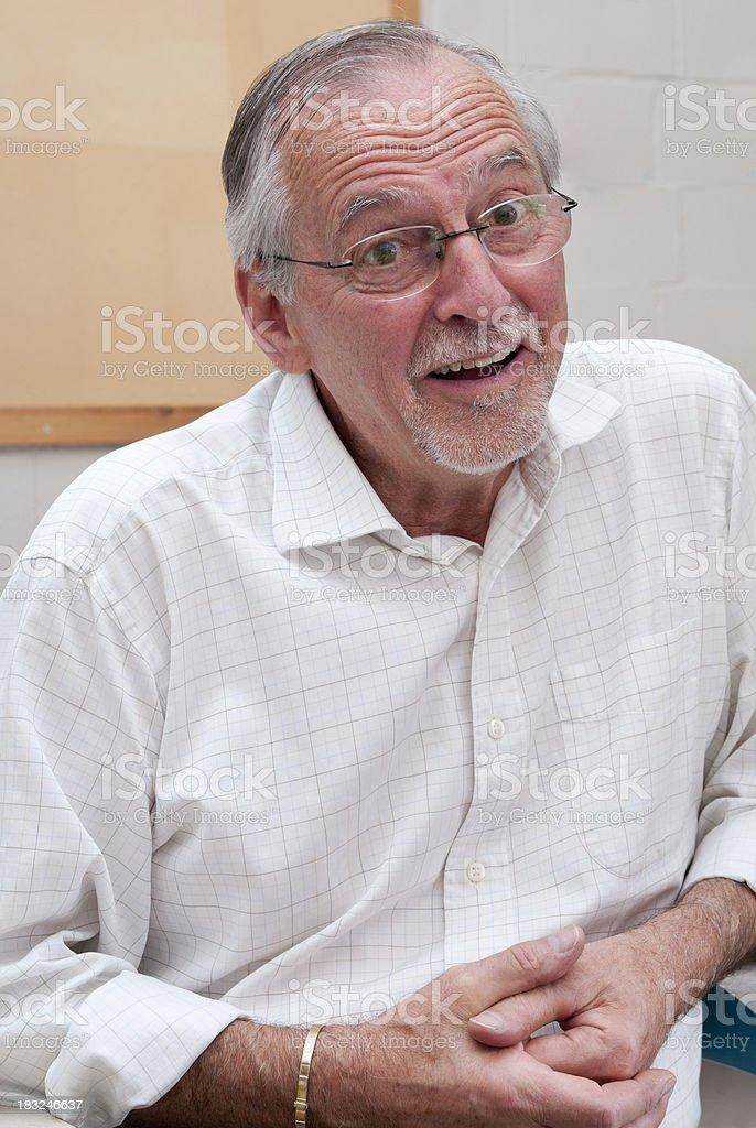 Senior man looking at you stock photo