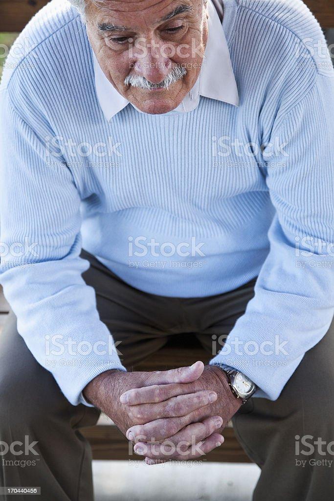 Senior man looking down stock photo