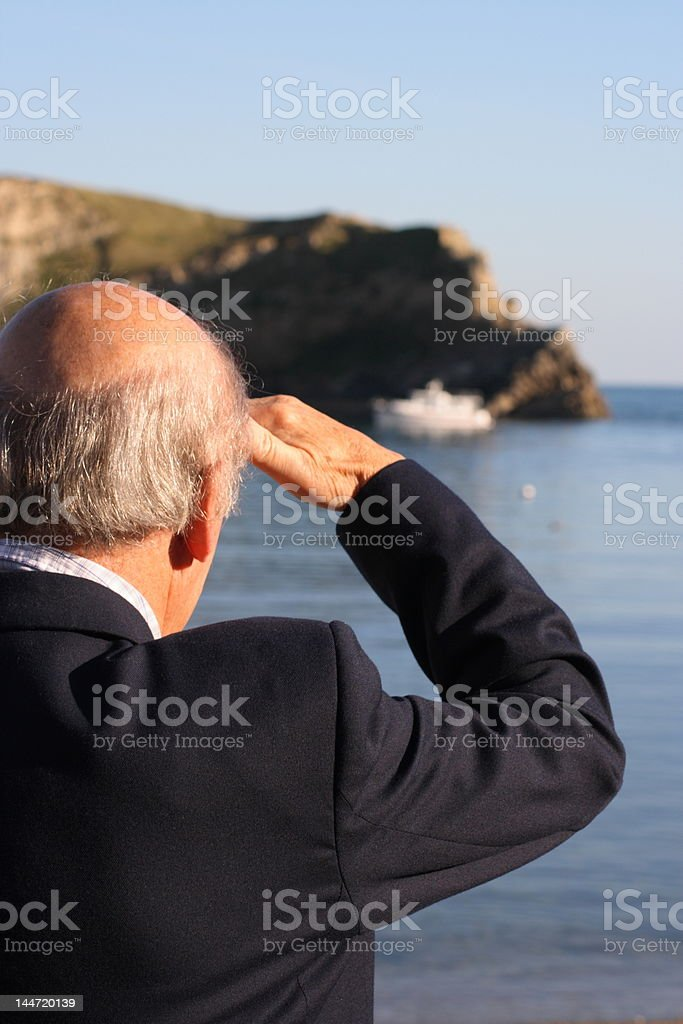 Senior man looking out to sea royalty-free stock photo